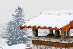 Snowy chimney Royalty Free Stock Images