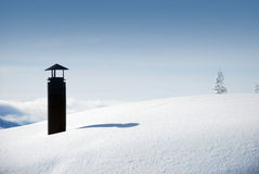 Snowy chimney. Snowy black iron chimney on snowy roof in winter mountains Stock Photos