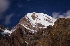 Night view to snowy Chimtarga peak in Fann mountains , Tajikistan royalty free stock photos