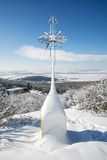 Snowy christian cross in outdoors Stock Image