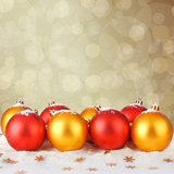 Snowy Christmas balls and gold stars Stock Images