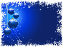 Snowy Christmas baubles Royalty Free Stock Photography