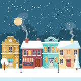 Snowy Christmas night in the cozy town greeting card Stock Photography