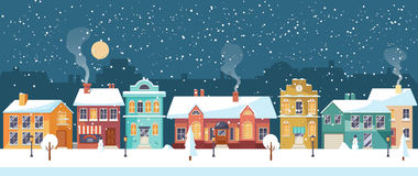 Snowy Christmas night in the cozy town, panorama Royalty Free Stock Photo