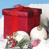 Snowy Christmas Pines Baubles and Gift Box Stock Image