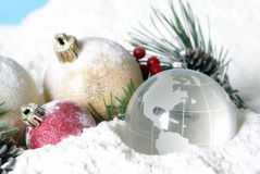 Snowy Christmas Pines Baubles and Globe Royalty Free Stock Photo