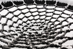 Snowy circular rope netting Royalty Free Stock Photo