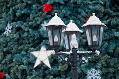 A snowy city light and christmas tree Royalty Free Stock Images