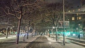 Snowy city streets at night Stock Photo