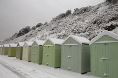 Snowy classic English beach huts stock images