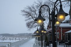 Lighted street lamp on the pier during snowy cold winter Stock Photography
