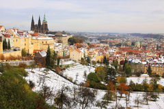Snowy colorful autumn Prague gothic Castle Stock Photo