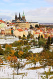 Snowy colorful autumn Prague gothic Castle, Czech Royalty Free Stock Photos