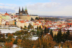 Snowy colorful autumn Prague gothic Castle, Czech Stock Images