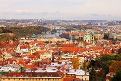 Snowy colorful autumn View on Prague City Stock Photos