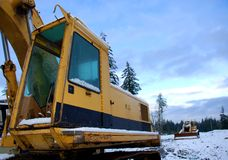 Snowy construction site. Spring Snowfall on Construction Site Stock Image