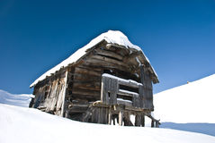 Snowy cottage. In mountains, Slovenia royalty free stock images