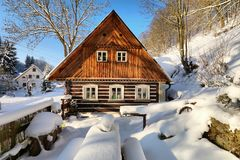 Snowy cottage in Czech republic Stock Photography