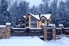 Free Snowy Cottage In Forest. Winter Landscape With Yellow Wooden Luxury House. Royalty Free Stock Images - 166180689