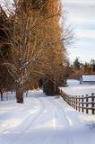 Snowy Country Lane and Fence Royalty Free Stock Photography