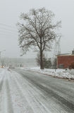 Snowy country lane on an overcast winter day Royalty Free Stock Photography