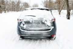 Snowy country road with car stock photography