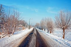 Snowy country road in the Netherlands Royalty Free Stock Photos