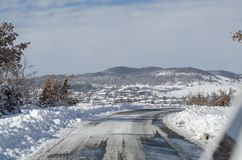 Snowy country road Royalty Free Stock Photography