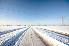Snowy countryroad the Netherlands Royalty Free Stock Photos