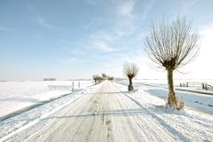 Snowy countryroad, in the Netherlands Stock Image