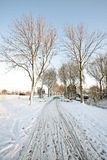 Snowy countryroad in the Netherlands Stock Images