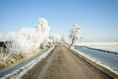 Snowy countryroad, in the Netherlands Stock Photo