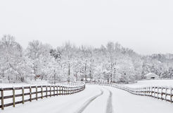 Snowy countryside driveway. Snow covered countryside driveway with wooden fencing Royalty Free Stock Photos