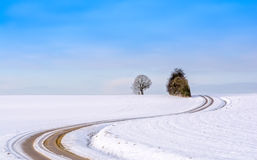 Snowy countryside lane Stock Photography
