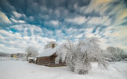 Winter landscape. Snowy countryside of little wooden houses near forest, Europe winter royalty free stock photography