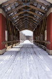 Snowy Covered Bridge - Eastern Ohio. A snowy covered bridge on the Maple Highlands Rail Trail in eastern Ohio stock image