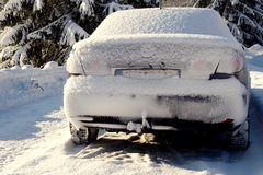 Snowy-covered vehicle. The snow was falling during the night, holiday in the mountains Stock Photos