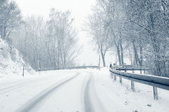 Snowy curvy country road Royalty Free Stock Photos