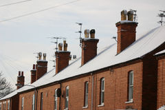 Snowy-Dachspitzen Lizenzfreie Stockbilder