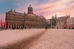 Snowy Damsquare in Amsterdam Netherlands at sunset Stock Image