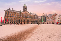 Snowy Damsquare in Amsterdam Netherlands at sunset Stock Photos