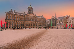 Snowy Damsquare in Amsterdam Netherlands at sunset Stock Photography