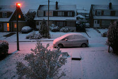 Snowy dawn in suburbia. Shot out of the window at dawn after a november nighty snowfall stock photography