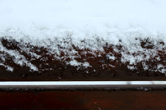 Snowy Day. Snowy Bench in extreme closeup Stock Photography