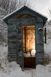 Snowy day outhouse stock photo