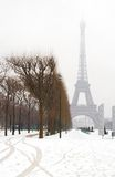 Snowy day in Paris. Misty Eiffel Tower and lots of snow Stock Image