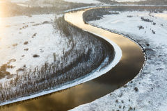 Snowy day on the river, top view Stock Photo