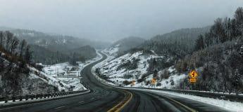 Snowy and desert road toward Lac Saint Jean stock photo