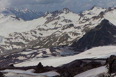 Snowy and deserted slopes of Mount Elbrus Stock Photo