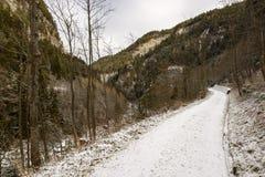 Snowy dirt mountain road, Thusis, Switzerland Stock Photos